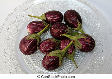 Brinjal - Purple, egg shaped vegetable with green, thorny...