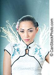 Beautiful Asian woman in Chinese Qipao