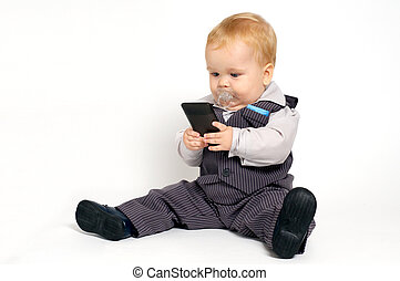 Baby texting - blond baby in suit texting with mobile phone