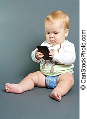 Baby texting smart phone - blond baby texting with smart...