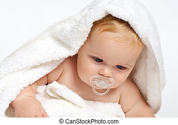 Baby wrapped in towel - Cute Baby with pacifier wrapped in...