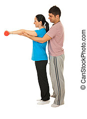 Trainer man helping woman