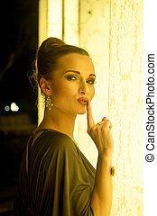 Elegant woman silent gesture - Pretty woman model with...