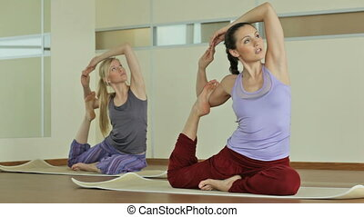 Yoga girls - Young women performing a complex of asanas...