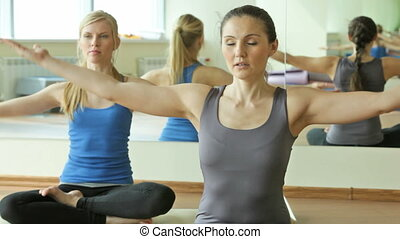 Hands held high - Yoga instructor doing breathing exercise...