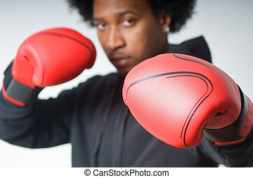 Defence boxing - Black Boxer with red boxing gloves