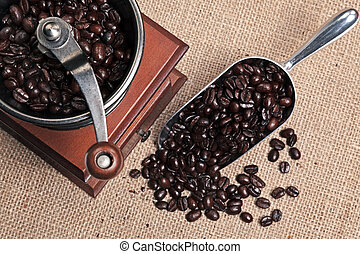 Coffee grinder and scoop full of beans