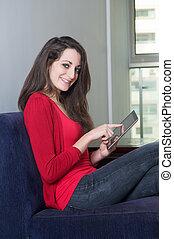 Beautiful girl pointing at ipad - Beautiful girl sitting on...