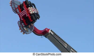 booster slow motion 01 - Fairground attractions at amusement...