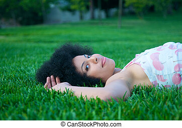 Attractive African American girl in nature