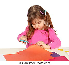 Little Child Girl Making a Cutout