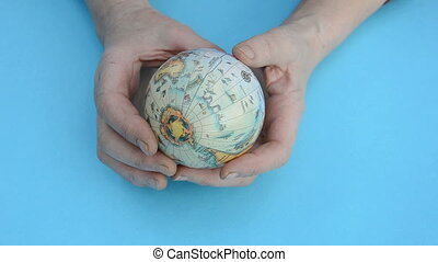earth globe in the old woman hands - earth globe symbol in...