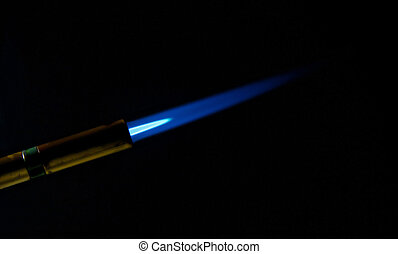 propane torch flame - blue flame from a propane torch on a...