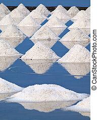 Salt farm - Heap of sea salt in a field prepared for harvest...