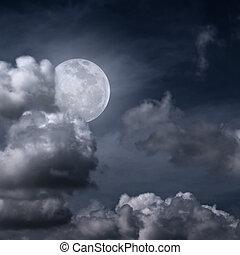Beautiful full moon behind fantasy cloudy sky