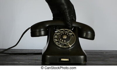 calling with vintage phone - hand with black glove calling...