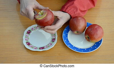 old woman hands peeling apple - old woman hands peeling red...
