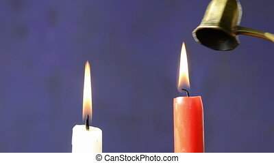extinguish two candles fire with brass extinguisher