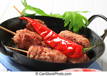 Minced meat kebabs on wooden sticks