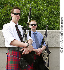 Relaxed Pipers - Bagpipe duo relaxing between songs as they...