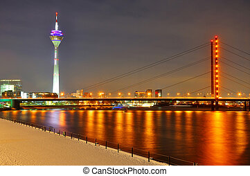 Beautiful night shore of Rhein river at night in Dusseldorf...