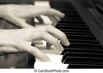 Hands of the musician on a synthesizer - hands of keyboard...