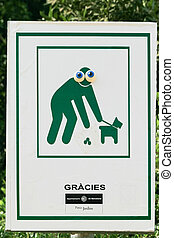 "Sign Clean up after your pet - Sign in park Guell ""Clean up..."