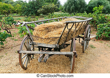 wooden wagon with hay