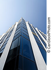 Office building under blue cloudless sky