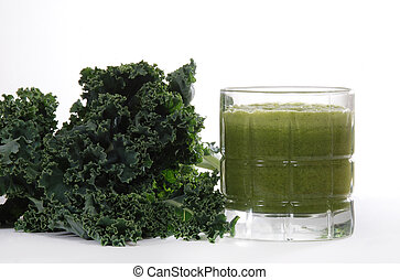 Kale and juice - Fresh kale leaves near juiced kale...