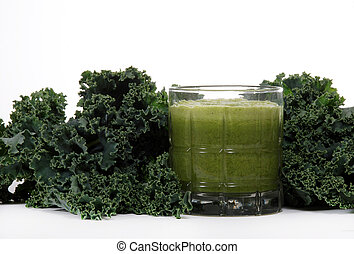 Kale and juice - Fresh kale leaves near juiced kale beverage...