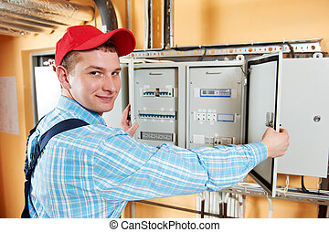 Electrician checking data - One electrician working with...