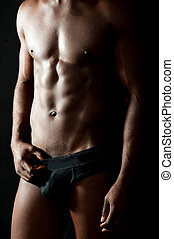 Naked torso of young muscular man. Stunning abs