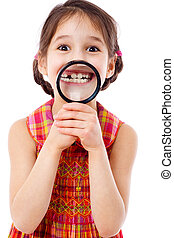 Girl showing teeth through a magnifier - Funny girl showing...