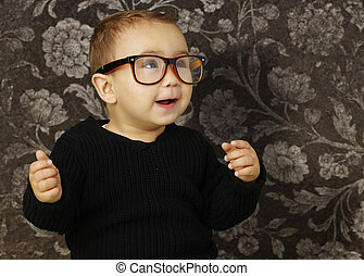portrait of adorable kid wearing vintage glasses against a vinta