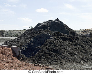 black mulch - pile of black mulch