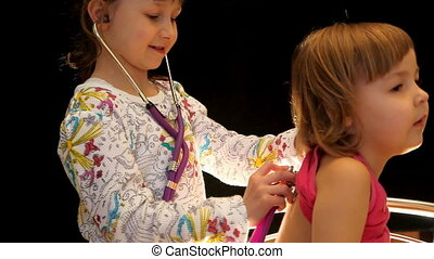 stethoscope  - girl with stethoscope listens to his sister