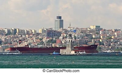 Cargo ship sailing in Istanbul - Red cargo ship moves in...