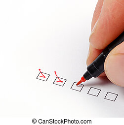 Checklist - Hand with red pen marking a check box