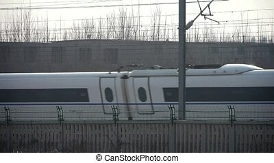 White high-speed train between the wire