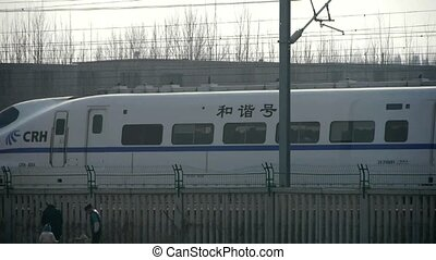 White high-speed train in railway - White high-speed train...