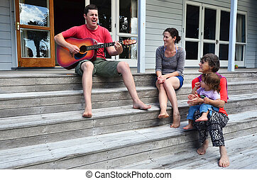 Family Moments - Music - Portrait of handsome lad playing...