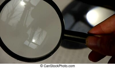 Focus of magnifying glass,In hand.