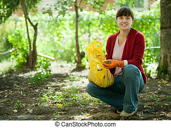 woman fertilizes the soil