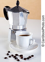 Moka pot and cup of espresso coffee