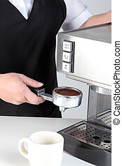 Barista using an espresso machine - Photo of a barista...