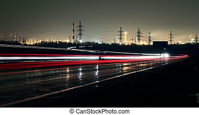 Car lights on a highway at night on the background of the...