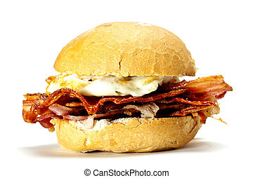 Bacon and egg bun - A delicious bacon and egg bun on a white...