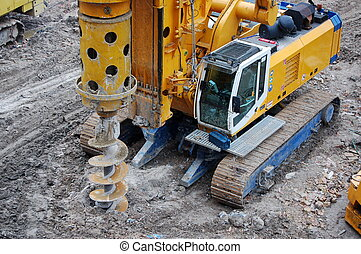 Caterpillar tractor drills earth