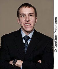 Business Success - Young business man with braces standing...